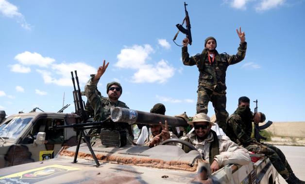 FILE PHOTO: Libyan National Army (LNA) members head out of Benghazi to reinforce troops advancing towards Tripoli, in Benghazi, Libya, April 7, 2019. REUTERS/Esam Omran Al-Fetori/File Photo
