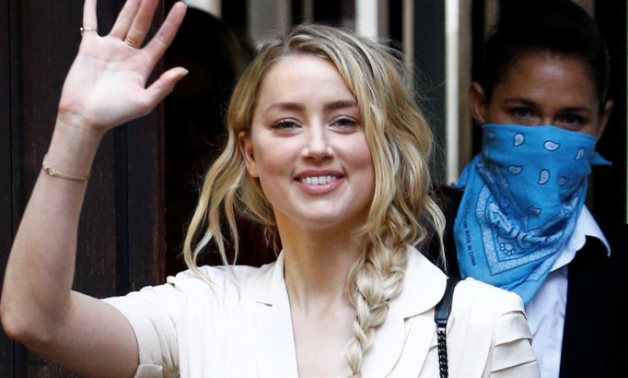 Actor Amber Heard waves as she arrives at the High Court in London, Britain July 20, 2020. REUTERS/Henry Nicholls