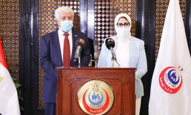 Egyptian Minister of Health and Population Hala Zayed with her counterpart Yemeni Minister of Health Nasser Ba'oom in Egypt, On July 20, 2020- press photo