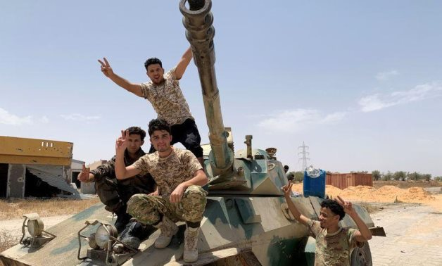 FILE PHOTO: Fighters loyal to Libya's Government of National Accord (GNA) celebrate after regaining control over the city, in Tripoli, Libya, June 4, 2020. REUTERS/Ayman Al-Sahili
