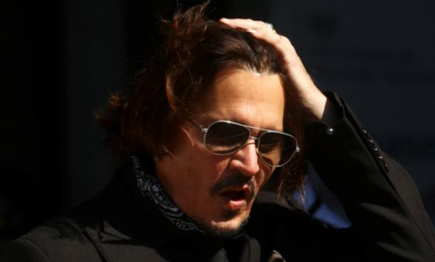 Actor Johnny Depp arrives at the High Court in London, Britain July 22, 2020. REUTERS/Hannah McKay