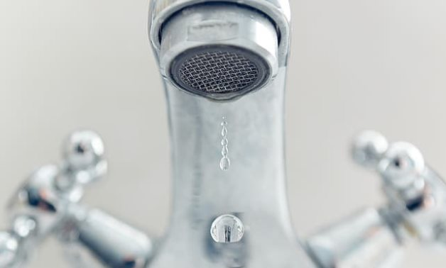 Photo of water dropped from gray stainless steel faucet- CC via Pikrepo
