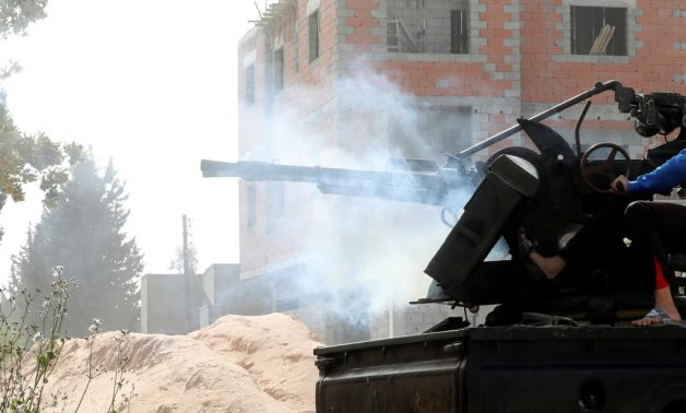 A member of the Libyan Government of National Accord (GNA) fires during a fight with Eastern forces in Ain Zara, Tripoli, Libya April 25, 2019. REUTERS/Hani Amara