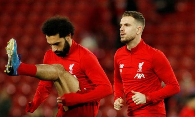 Liverpool's Jordan Henderson and Mohamed Salah during the warm up before the match REUTERS/Phil Noble