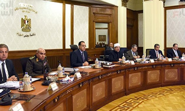 FILE PHOTO- Ministers partake in a Cabinet meeting