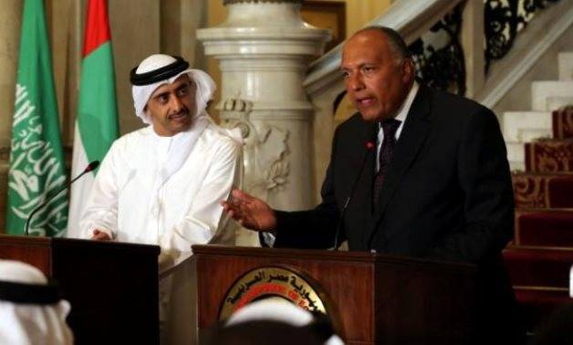 FILE - UAE Foreign Minister Abdullah bin Zayed Al-Nahyan listens as Egyptian Foreign Minister Sameh Shoukry speaks during a press conference – Reuters/Khaled Elfiqi