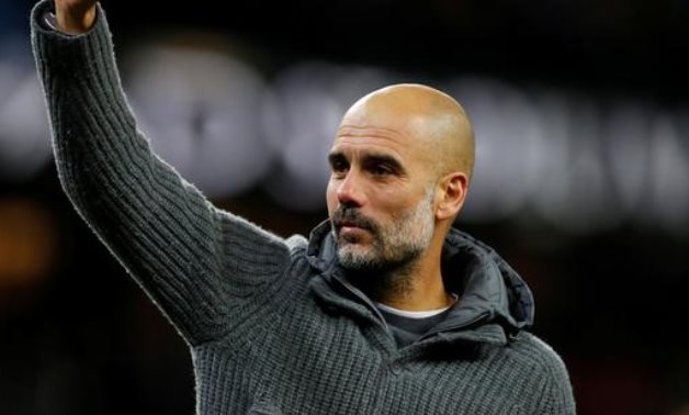 Guardiola during a lap of appreciation after the match REUTERS