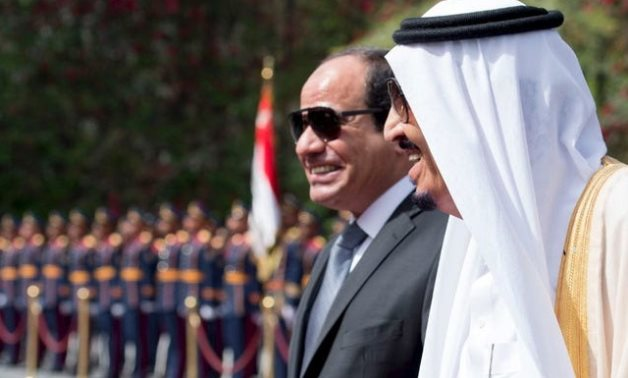 Egypt's President Abdel Fattah al-Sisi and Saudi Arabia's King Salman review the honour guards in Cairo - Thomson Reuters