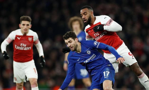 Chelsea's Kovacic in action with Arsenal's Lacazette Reuters