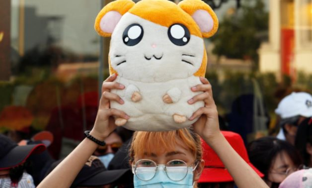 "FILE PHOTO: A demonstrator holds a soft toy ""Hamtaro"" during a protest demanding the resignation of Thailand's Prime Minister Prayuth Chan-o-cha, in Bangkok July 26, 2020. REUTERS/Jorge Silva/File Photo"