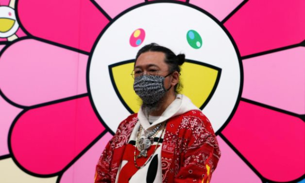Japanese artist Takashi Murakami wearing a face mask speaks to reporters  in Tokyo, Japan, July 30, 2020. REUTERS/Chris Gallagher