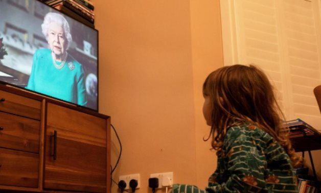 FILE PHOTO: Isaac (4) watches Queen Elizabeth II during a televised address to the nation, London, Britain, April 5, 2020. REUTERS/Simon Dawson/File Photo