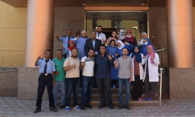 File- Staff at Luxor General Hospital celebrate the end of the quarantine- press photo