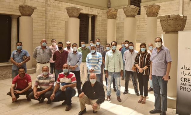 "Staff of the Coptic Museum taking a group photo during the training workshop titled: ""Tourism Ambassadors"". - Photo Via Egypt's Min. of Culture"