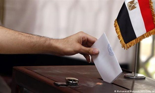 Casting ballot in Egyptian elections - FILE