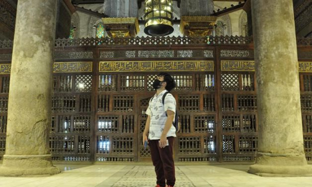A tourist captivated by Egypt's historical cultural sites - photo via Egypt's Min. of Tourism & Antiquities