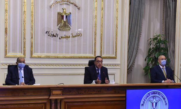 Egypt's Prime Minsiter Mustafa Madbouli (middle) speaks in a press conference attended by a number of ministers including the housing minister (R) and the local development minister – Cabinet