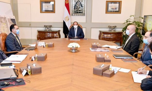Egypt's President Abdel Fattah El Sisi meets with the prime minister and the minister of housing - Presidency