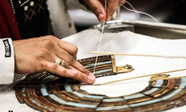 The precise restoration process of one of Tutankhamun's belongings being restored in the GEM - ET