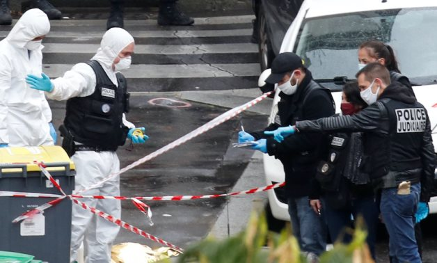 Forensic experts work at the scene of a stabbing attack near the former offices of French magazine Charlie Hebdo, in Paris, France September 25, 2020. REUTERS/Gonzalo Fuentes