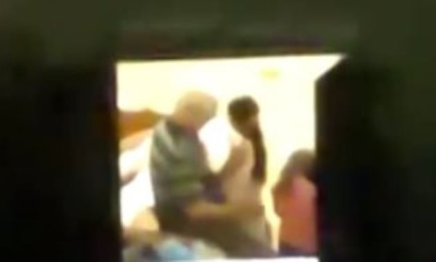 A teacher was arrested after a video showing him harassing a girl and kissing her in a room - Screenshot of video