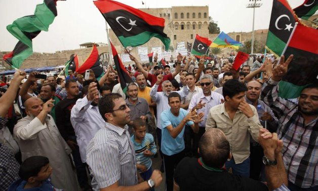 Libyans celebrate after the Supreme Court invalidated the country's parliament, at Martyrs' Square in Tripoli November 6, 2014. REUTERS/Ismail Zitouny