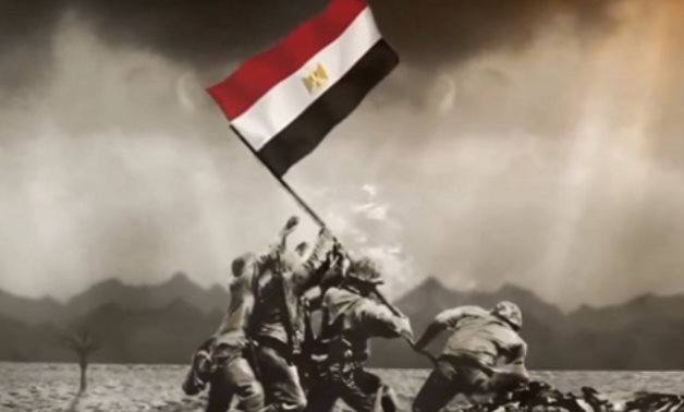 FILE - Egyptian soldiers raise the Egyptian flag high in the sky during the October Victory