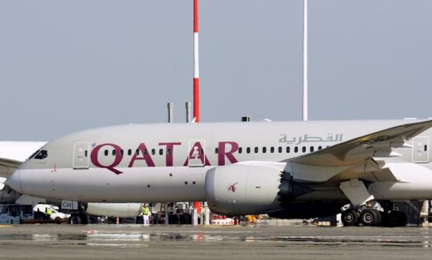 FILE: A Qatar Airways Boeing 787-8 Dreamliner airplane is pictured at Leonardo da Vinci-Fiumicino Airport in Rome, Italy, March 30, 2019. REUTERS/Alb