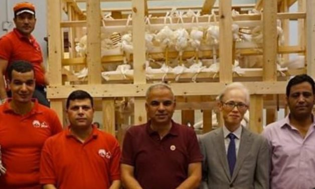 Part of the awarded project team - photo via Egypt's Min. of Tourism & Antiquities