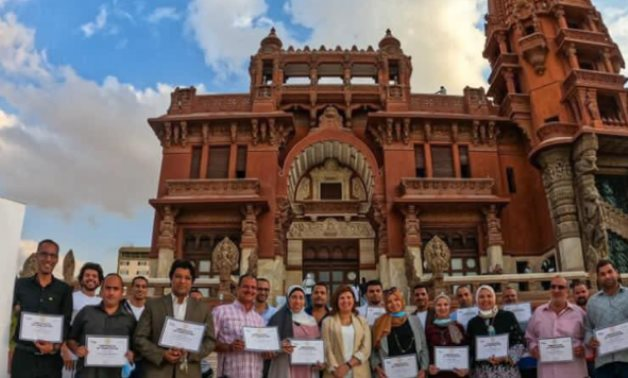 The trainees taking a memorial photo in front of the Baron Empain Palace in Heliopolis - photo via Egypt's Min. of Tourism & Antiquities