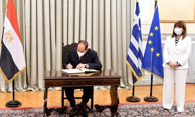 FILE- President Abdel Fattah El Sisi signs an agreement with Greece in Athens, on November 2020- press photo