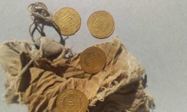 File: The newly uncovered gold dinars.