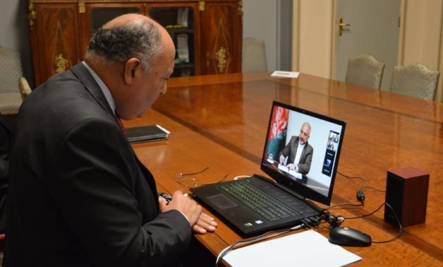 Minister of Foreign Affairs Sameh Shokry talking to Afghan counterpart - Mohammad Hanif Atmar via video-conference on November 17, 2020. Press Photo