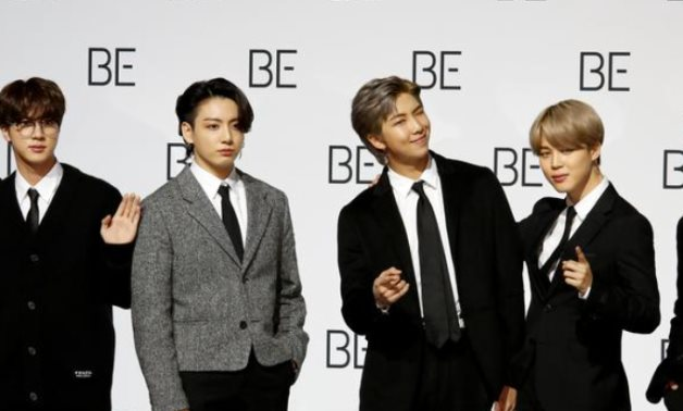 "FILE PHOTO: Members of K-pop boy band BTS pose for photographs during a news conference promoting their new album ""BE(Deluxe Edition)"" in Seoul, South Korea, November 20, 2020. REUTERS/Heo Ran"