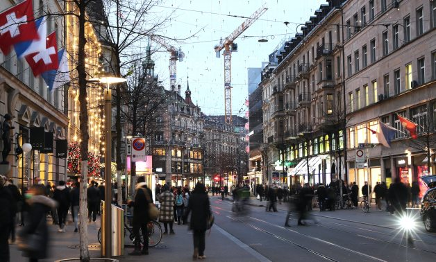 People walk under Christmas illuminations, as the spread of the coronavirus disease continues, on Bahnhofstrasse shopping street in Zurich, Switzerland November 2020. Picture taken with long exposure. REUTERS
