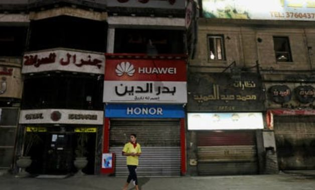 A man walks in front of closed shops in Cairo. (File photo: Reuters)