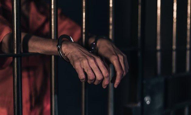 FILE - A handcuffed person inside a prison – Pxfuel