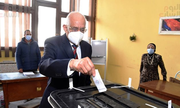 Egyptian Parliament's Speaker Ali Abdel al-Aaal casting his vote in the run-off phase of the second round of parliamentary election.