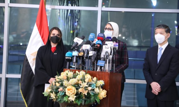 Egyptian Health Minister speaks in a press conference, along with Chinese Ambassador to Egypt and acting Emirati Ambassador Mariam Al-Kaabi, after the arrival of the 1st batch of the vaccine at Cairo Airport