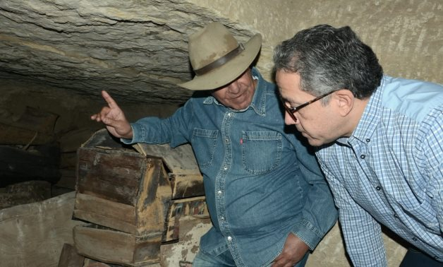 Egypt's Minister of Tourism & Antiquities Khaled el-Enani (R) with renowned archaeologist Zahi Hawass in one of the burying wells - Photo via Egypt's Min. of Tourism and Antiquities