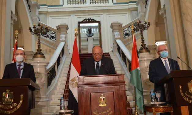 File- Egypt's Foreign Minister Sameh Shoukry  (C), Jordanian FM Ayman Safadi (L) and Palestinian Riyad El-Malky (R ) in a press conference in Egypt on December 19, 2020- press photo