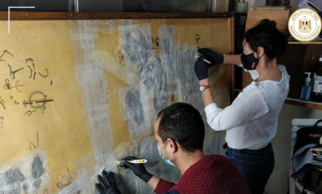Experts working on the mural - photo via Egypt's Min. of Tourism & Antiquities