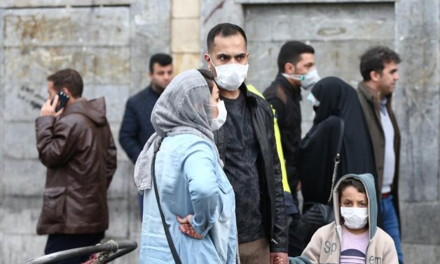Iranian family wear protective masks to prevent contracting a coronavirus, as they stand at Grand Bazaar in Tehran, Iran February 20, 2020. WANA (West Asia News Agency)/Nazanin Tabatabaee via REUTERS