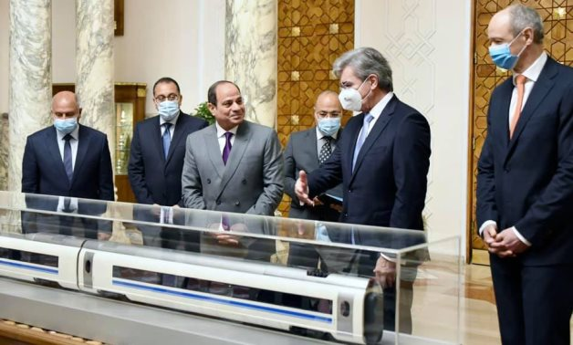 FILE - Sisi meets with Siemens CEO Joe Kaeser where they reviewed the final agreement on the establishment of the electric train system.- Presidency