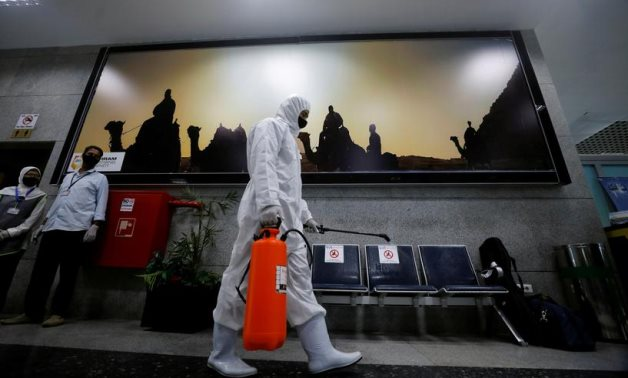 A worker sprays disinfectant at Hurghada International Airport in Egypt, June 18, 2020 – Reuters