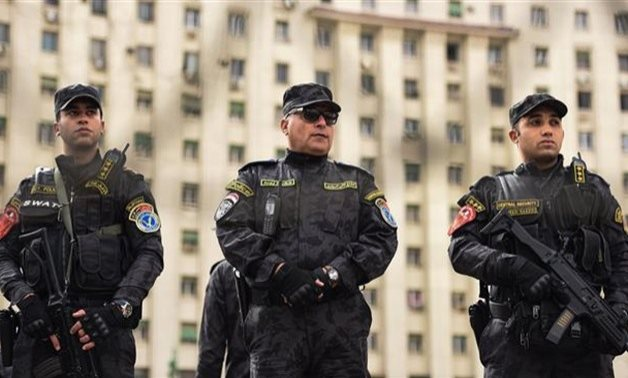 FILE – Egyptian police personnel in Cairo's Tahrir Square