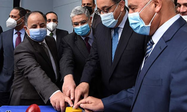 Prime Minister Mostafa Madbouly and Transport Minister Kamel al-Wazir push the button to start the tunnel-boring machine - Youm7