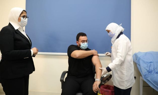 FILE - Egypt vaccinates the first doctor included in the Health Ministry's anti-coronavirus campaign, January 24 - Egyptian Health Ministry