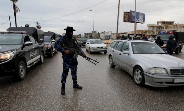 FILE PHOTO: A member of the central security support force holds a weapon during a security deployment in the Tajura neighborhood, east of Tripoli, Libya December 30, 2019. REUTERS