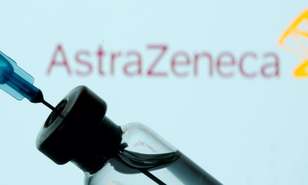 FILE PHOTO: A vial and sryinge are seen in front of a displayed AstraZeneca logo in this illustration taken January 11, 2021. REUTERS/Dado Ruvic/Illustration/File Photo/File Photo
